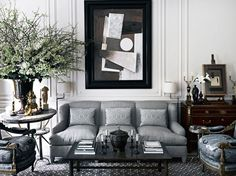 Shades of gray and a melange of styles in the living room, with a rug designed by Howard Slatkin. - HarpersBAZAAR.com