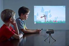 "handheld projector = 80"" touchscreen"