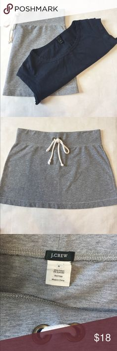 """J. Crew Cotton Skirt and Tee J. Crew Grey cotton skirt with faux drawstring waist. 14"""" long. Size S. Navy Tee with cap sleeves. 16"""" pit to pit. 22.5"""" long. Size XXS. Both in excellent condition. Cool casual look! J. Crew Skirts Skirt Sets"""