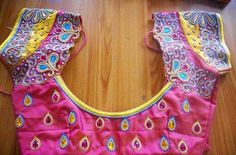 5 Mesmerizing Bridal Blouse designs for your Big Day Cut Work Bridal Blouse Heavy work Design for Neck and sleeve with Matching lining & Chain stones  French Knot Attached Bridal Blouse Designs Designed with Zardosi & Beads work and finished with French Knot  Zari Work Crystal Beauty Work …