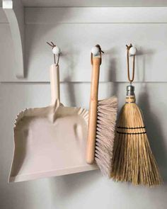 Laundry room tools | Dust pan, duster + broom with short handles hanging on wall hooks | Martha Stewart