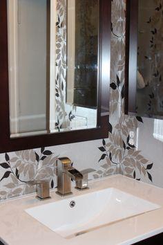 A bold, modern wallpaper gives this small bathroom real drama. #ranchointeriordesign.com Repin if you like this look