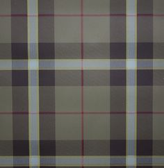 Winslow Plaid Wallpaper A tartan wallpaper in chestnut and taupe with thin burgundy stripes.
