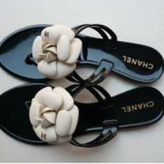 Authentic CHANEL Chamellia Roses Thong Sandals Gorgeous and authentic CHANEL sandals. They're in really good condition on the soles and straps. The flowers have picked up some dirt and need to be cleaned and the right flower is missing the middle part. Priced low due to these two things. The parts with the golden CHANEL logo are still intact on both shoes. They fit like a 7.5. No trades. Offers welcome. Happy Poshing!  CHANEL Shoes Sandals