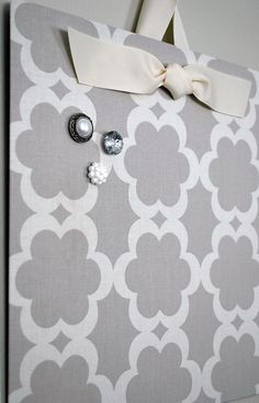 flat cookie sheet covered in fabric becomes a cute magnet board