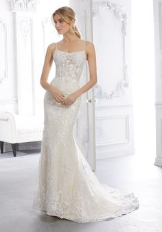 This net over Chantilly lace fit and flare wedding dress features a square neckline, spaghetti straps, and a corset back. Affordable Wedding Dresses, Bridal Wedding Dresses, Designer Wedding Dresses, Bridesmaid Dresses, Pageant Dresses, Quinceanera Dresses, Always And Forever Bridal, Net Gowns, Allure Couture