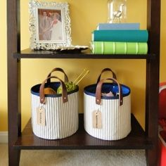 A full tutorial to creating a charming set of fabric storage baskets with leather handles.