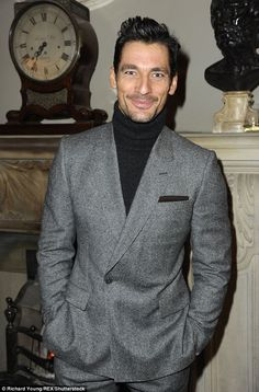 Model behaviour: David Gandy, 35,looked on-trend in a grey tailored suit. He teamed it with a black polo neck jumper to keep the winter chill at bay as he beamed on the day