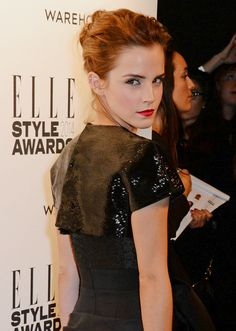 Emma Watson is chic in a beaded black stylish dress at the Elle Style Awards 2014 held at One Embankment on Tuesday (February 18) in London, England.