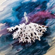 Belle, cut snowflake and watercolor on paper, by Love Limzy
