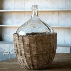 This lovely recycled glass cellar bottle sitting in a willow basket is reminiscent of our favorite french farmhouse decor. French Farmhouse Decor, Antique Farmhouse, Glass Milk Bottles, Wire Baskets, Recycled Glass, Cellar, Design Inspiration, Dining, Things To Sell