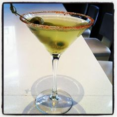 Our Beverage Manager Iris created a spicy new cocktail called the Piccantini: Stoli Hot martini with muddled serrano peppers & cucumbers, sugar & red pepper powder rim and cucumber stuff olives. Photo via Instagram.