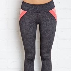 Heathered Color Block Yoga Legging Best fitting workout legging! Heathered black color, full length. Pink color block detailing on hips, color is quite faded from washing with darker colors. Small pocket in waistband. Other than pink fading/discoloration pants are on good condition.  NO TRADES, NO EXCEPTIONS!  Forever 21 Pants Leggings