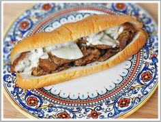 Slow Cooker Cheesesteaks -- london broil, bell pepper, onion, beef bouillon, worcestershire sauce, salt and pepper, sub rolls, provolone cheese