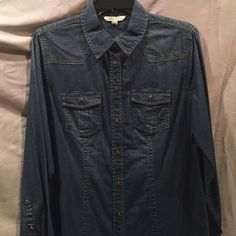 "CAbi McQueen shirt Not just any denim shirt. ""Worn"" but clean cut look, could also be worn open for a jean jacket look. Never worn. CAbi Tops Button Down Shirts"