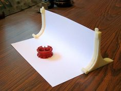 Would be great for small jewelry items! Photographic Sweep Stand 3D Print model on Thingiverse