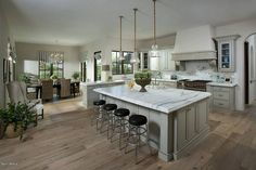 Traditional Kitchen with Calacatta Lincoln Marble Countertop, Complex Marble Tile, Inset cabinets, Custom hood, Breakfast bar