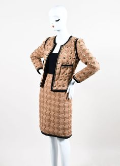 This suit is a limited edition Chanel design from the 2008 collection. Constructed of wool and lined with a silk blend. Features a large weave and black ribbon piping throughout. The open front jacket