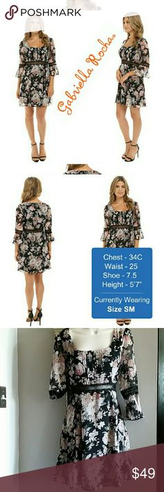 """Gabriella rocha floral sheer seam pink black dress Ladylike floral print with sheer seam detail at waist and cuffs.  Round neckline with button-loop placket.  Three-quarter sleeves with bell cuffs.  Blousey silhouette.  Straight hem on the layered A-line skirt.  100% polyester;Lining: 100% polyester.  Machine wash cold and line dry.  Length: 33""""  Brand New with Tags   I am a size 12 (38C) and it will not fit me 😔  This will fit more like a size 8 and/or 10  Tag says #Large but I am listing…"""