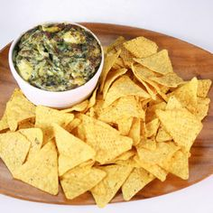Clinton kelly's Spinach Artichoke Dip...The Ches Show.... ingredients 1/3 cup Mayonnaise1/3 cup Cream Cheese1/4 cup Sour Cream1 cup freshly grated Parmesan Cheese1 cup chopped Marinated Artichokes (...