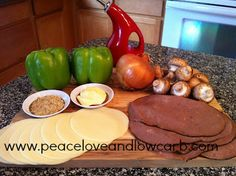 Philly Cheesesteak Stuffed Peppers! Onion, mushrooms, pro alone cheese, sliced roast beef, butter and bell peppers- YUMM!