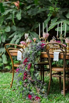 Cascading table florals | Ricky Ebel Photography| See more: http://theweddingplaybook.com/vintage-floral-wedding-inspiration/