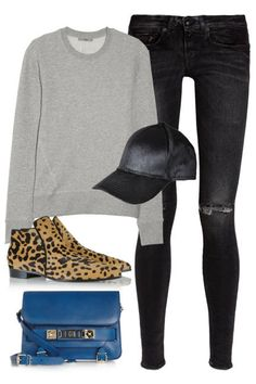 Calf-hair accessories and a bright bag up the cool factor of a gray sweatshirt.