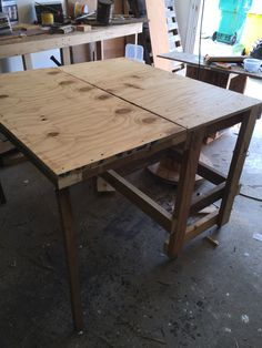Shop table with fold down