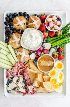 This gorgeous Easter Brunch Grazing Board is the perfect menu for any Easter or spring gathering. It features traditional Easter brunch favorites like hot cross buns, soft boiled eggs, and is the perfect balance of savory and sweet! #easterbrunch #grazingboard #grazingplatter #partyplatter #eastermenu #sweetcayenne #Hotcrossbuns | www.sweetcayenne.com