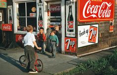 Vintage shot in late summer evening. Kids, coke and a bike. Great colors.