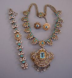 HOBE  necklace in aqua and clear  with detachable brooch, matching bracelet and earrings. The wearable length  of the necklace is 17 with 2-3/4 brooch.