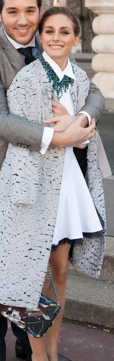 Who made Olivia Palermo's white dress, print handbag, and gray coat?