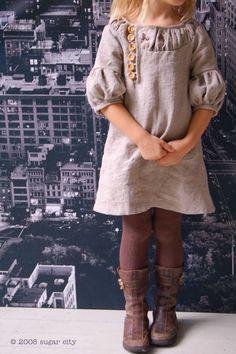 neutral dress, tights, boots.