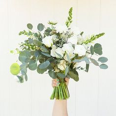 Wedding Flower Bouquets Gorgeous DIY eucalyptus and ranunculus wedding bouquet - In this article we share how you can incorporate eucalyptus into your wedding bouquet. including tips on care and availability! Ranunculus Wedding Bouquet, Eucalyptus Bouquet, Eucalyptus Wedding, Diy Wedding Bouquet, White Wedding Bouquets, Bride Bouquets, Floral Wedding, Wedding Flowers, Diy Wedding