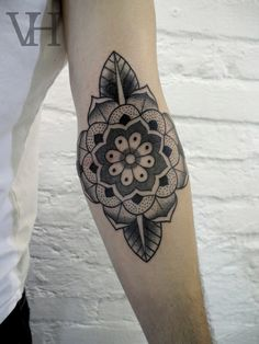 geometric flower  tattoos ink