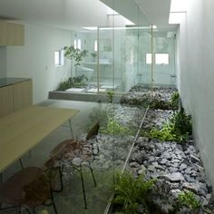"""House in Moriyama: Architect: Suppose design office Location: Nagoya, Japan Project Year: 2009  Main feature of the building, the """"Garden Room"""" extends the exterior to the interior of the living spaces."""