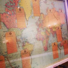Another great example of a world map themed seating plan with luggage labels used for table and guest names.