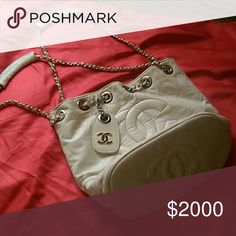 Chanel purse Bone color bucket chanel purse it has a couple ink spots inside on the leather and one little spot on back of purse next to bottom(see pics) it was a gift so I don't any papers I've had it for about 10 years.. CHANEL Bags Shoulder Bags