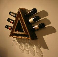 Triangular Wine Rack(by Douglas Schneider [Doug]) Wine Rack with Hanging Glass Storage constructed from salvaged cedar planks.Triangular in design. The inner and outer triangles support the glasses, wine bottle