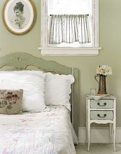 Oh my heck.... THIS is what I want my bedroom to look like!!!!Old fashioned green bedroom, soft green paint distressed furniture, white linens. love the cute half curtain, too.