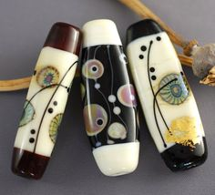 Jane Perala Designs, lovely shape and patterns if color. These could be accented in so many ways.