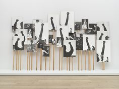 """Annette Lemieux, """"Left Right Left Right"""" 30 photolithographs and 30 pine poles, dimensions variable (Whitney Museum of American Art, New York; purchase, with funds from the Print Committee; courtesy the Whitney Museum of American Art) Museums In Ny, Henry Art Gallery, Hirshhorn Museum, Exposition Photo, Photo Sculpture, Protest Art, Photography Exhibition, Political Art, Whitney Museum"""