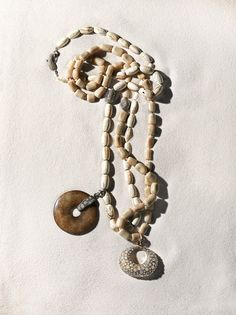 URBAN SAFARI - let's make sand castles & find Loree Rodkin jewelry. 212 872 8744