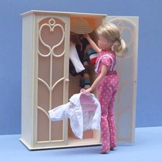 Sindy wardrobe. I had Sindy but always wanted Barbie!- My husband built one of these for my daughter when she was little.  She had little hanger and hung all her doll clothes in it.