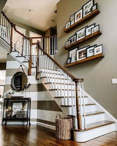 How to Decorate Picture Ledges — The Decor Formula Decorating Stairway Walls, Stair Walls, Staircase Wall Decor, Stair Decor, Staircase Design, Stair Landing Decor, Ideas For Stairway Walls, Picture Shelves, Picture Ledge