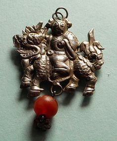 The design of a smiling man on a Shinese Lion with one hanging agate gem : the style is an ornamental pendant. The pendant is made of old Chinese silver, but its purity is not calculated. Origin of the item is one of the silver jewels crafted in the middle or late Quing Dynasty. | eBay!