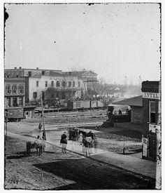 [Atlanta, Ga. Soldiers on boxcars at railroad depot]