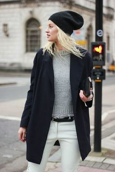 Stand out among other stylish civilians in a black coat and white jeans.   Shop this look on Lookastic: https://lookastic.com/women/looks/coat-crew-neck-sweater-jeans/14235   — Black Beanie  — Grey Crew-neck Sweater  — Black Leather Clutch  — Black Coat  — Black Leather Belt  — White Jeans