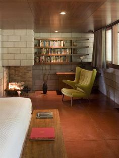 Another room with Frank Lloyd Wright inspiration! Love the #wood and corner fireplace!
