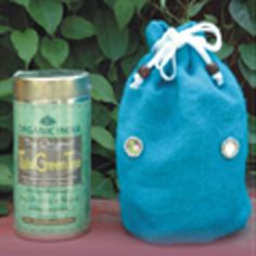 Blue Jute Economy Gift Bag - This trendy bright blue jute bag comes filled with your choice of any 100 gm tin of ORGANIC INDIA Tulsi Tea - The Original Tulsi, Tulsi Ginger, Tulsi Green Tea or Tulsi Chai Masala.